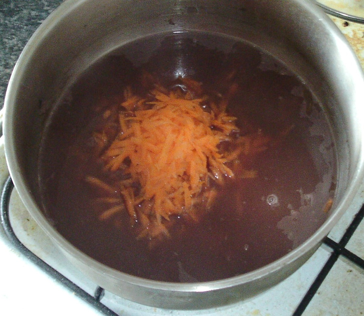Carrot is grated in to red wine gravy