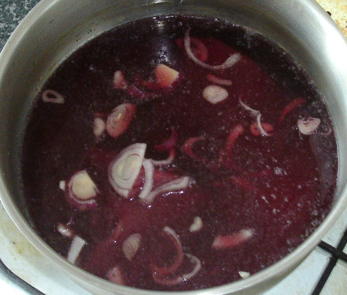 Red wine and stock is added to venison