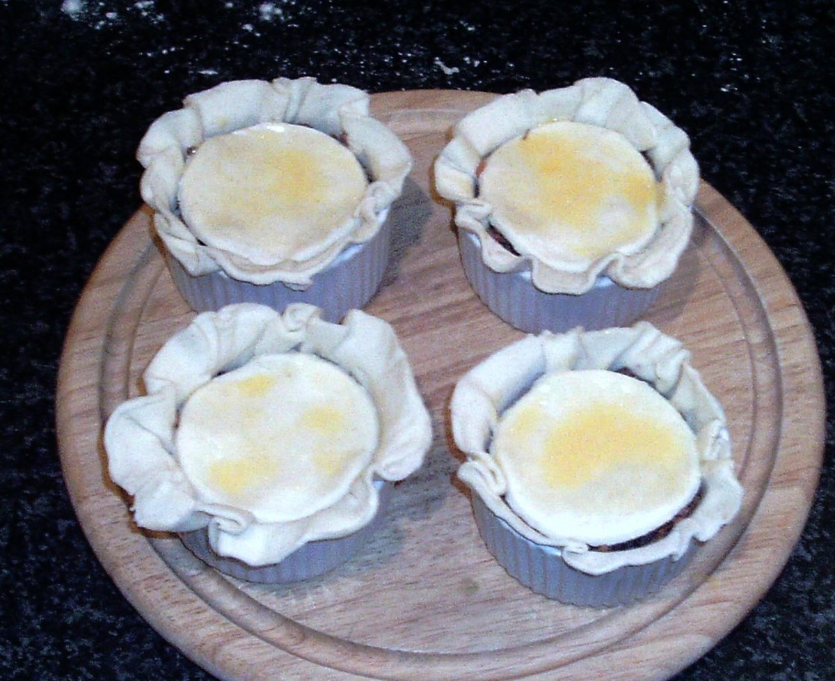 Pie lids are glazed with beaten egg