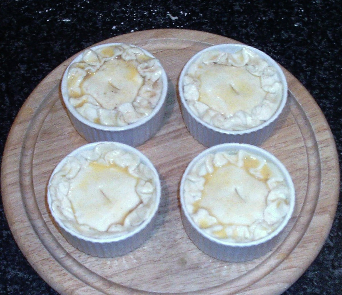 Assembled and glazed pies are ready for the oven