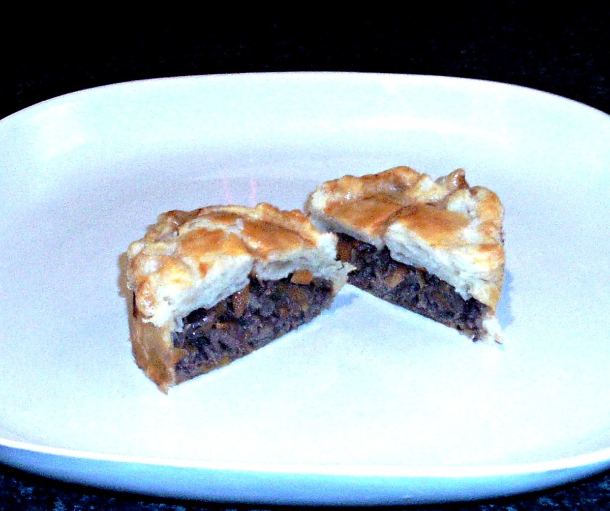 Cut open venison and red wine gravy pie