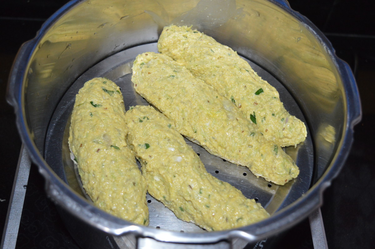 Step three: Knead together to make a firm, smooth dough. If needed, use bottle gourd water for kneading the dough. Divide the dough in four equal portions. Shape each of them like a cylindrical roll.