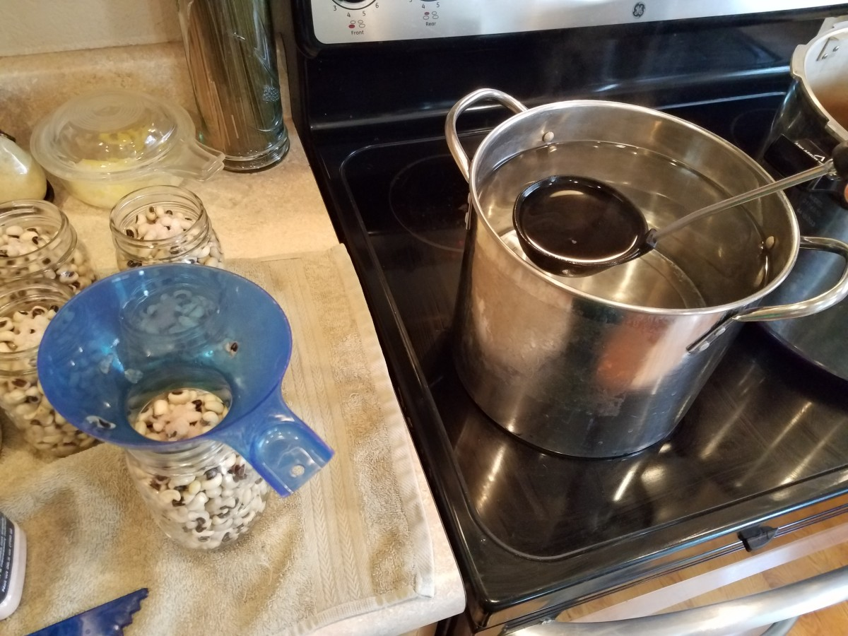Step Nine: Fill each jar to the bottom of each jar neck with boiling water.