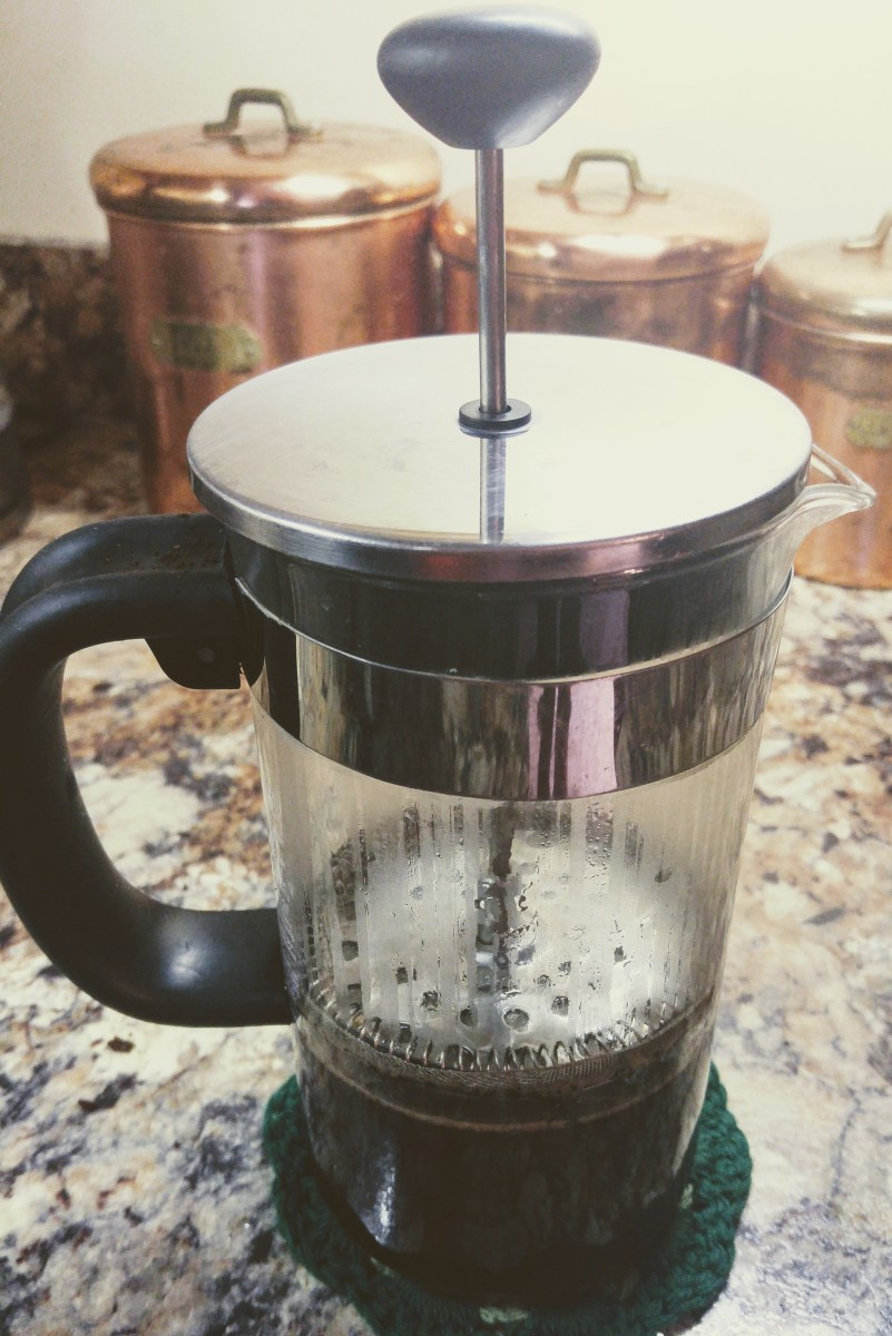 A typical French press coffee pot