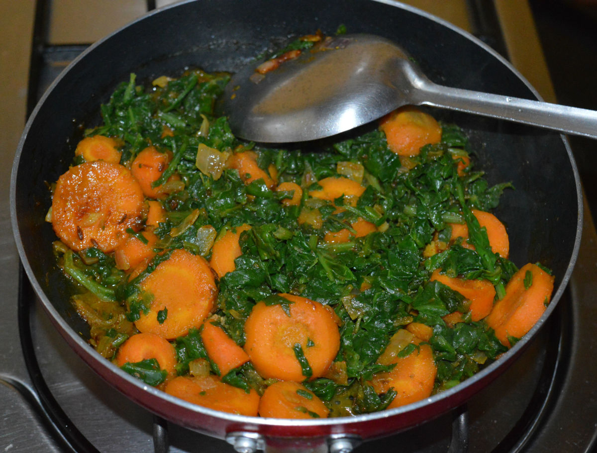 Next, open the lid. Cook until carrots are soft and the mixture becomes almost dry.