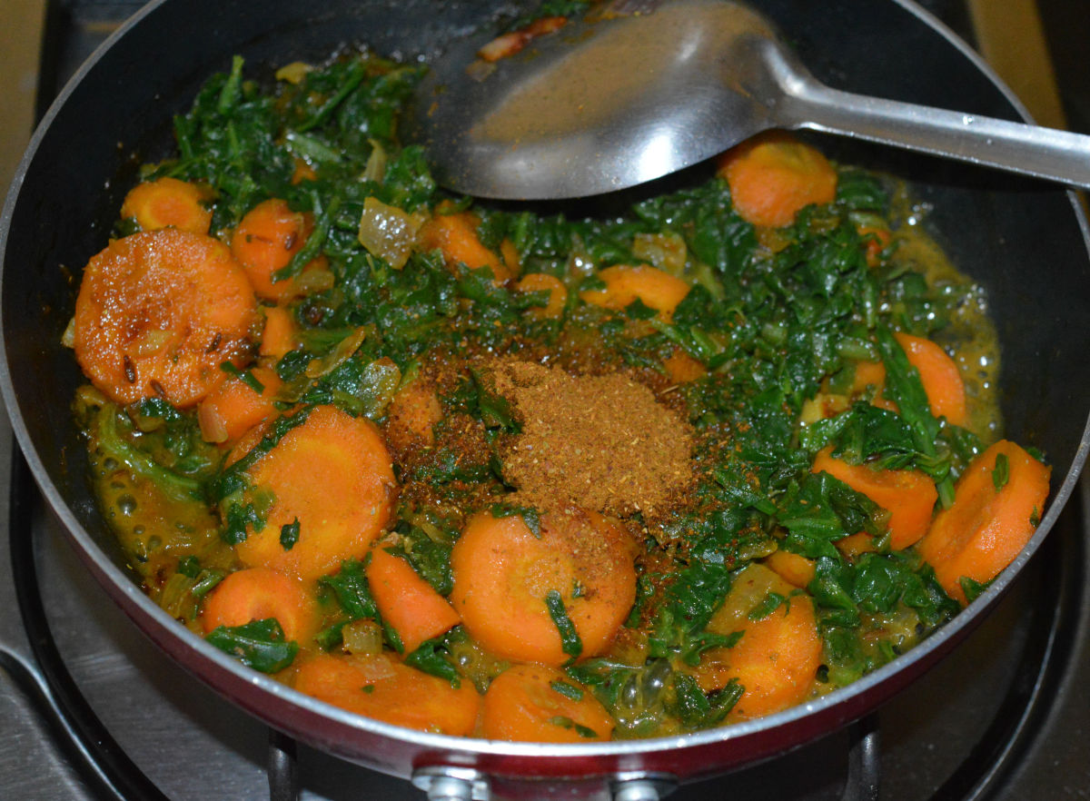 Step five: Add garam masala powder. Mix well. Turn off the heat. Your favorite spinach carrot curry is ready!