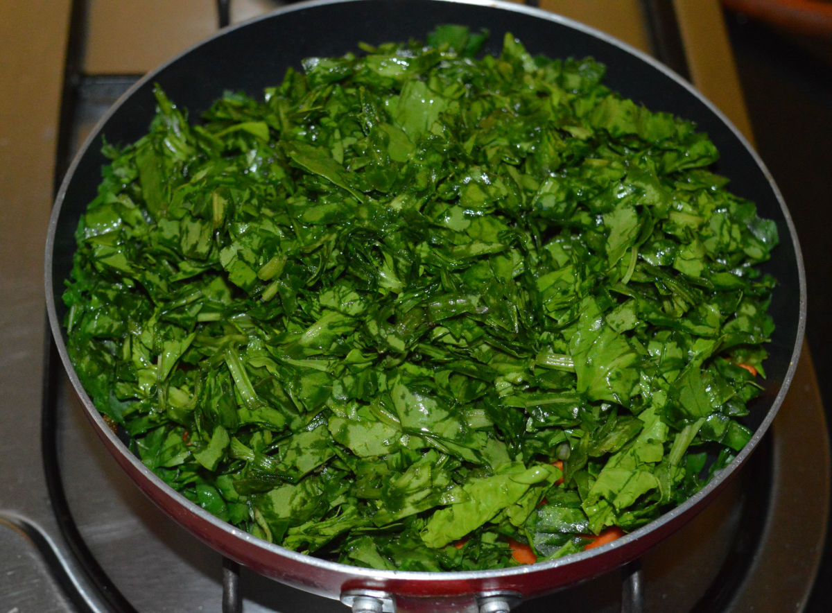Step four: Add chopped spinach. Cover the pan. Cook over medium heat for five minutes. No need to add water. Spinach will release its water.