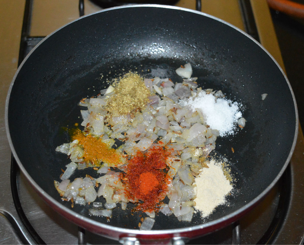 Step two: Add dry masala powders as per instructions. Throw in salt. Saute for a few seconds.