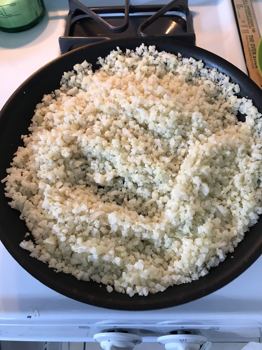 It's important to get the moisture out of the cauliflower rice in a dry skillet.