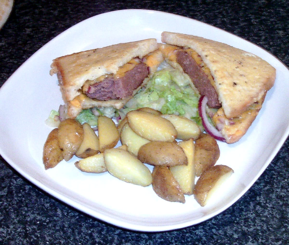 Enjoying cheesy Belgian blue beef burger and eggy bread sandwich