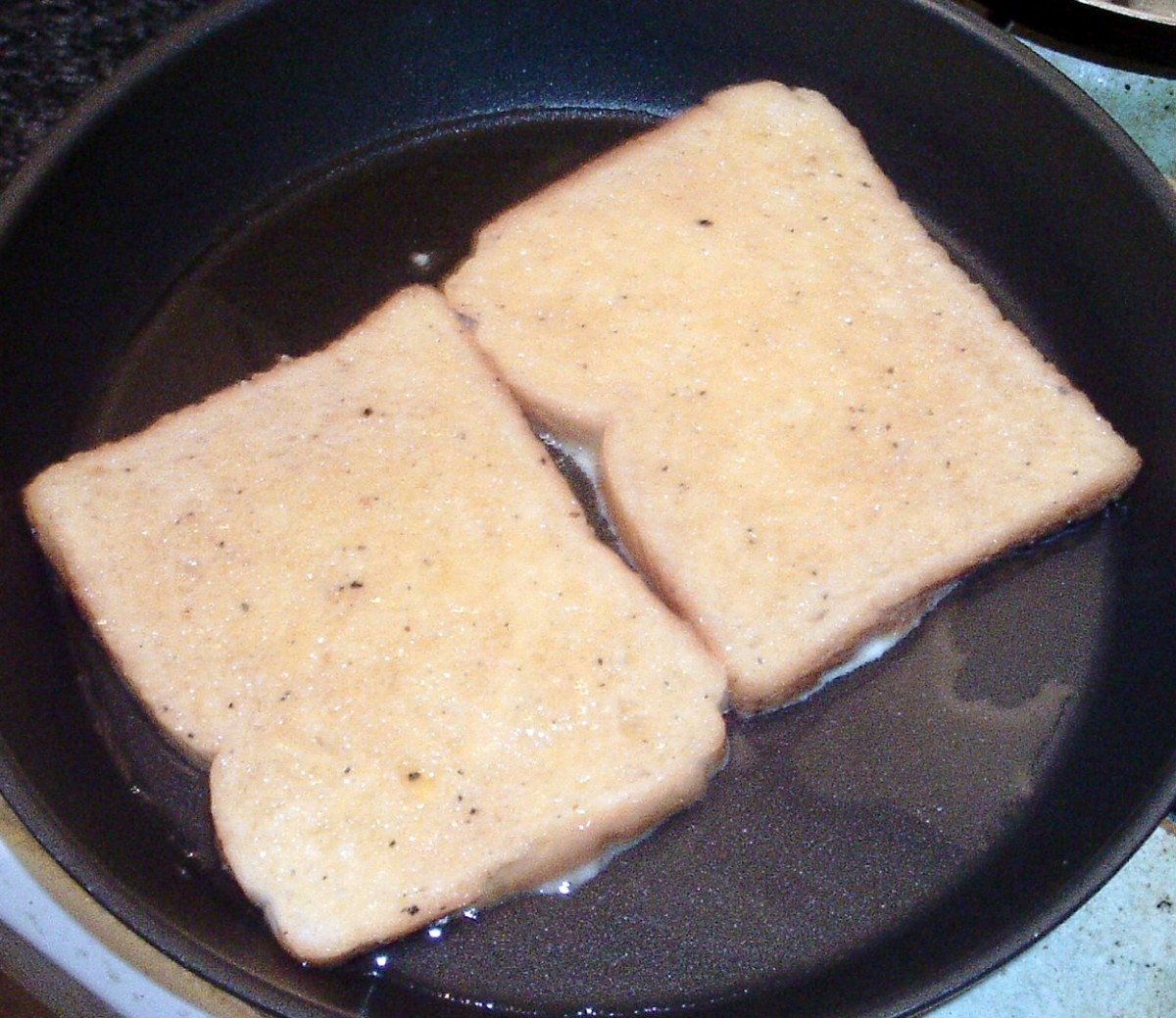 Eggy bread is added to frying pan