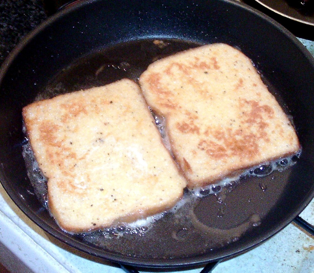 Eggy bread is turned to fry on second side