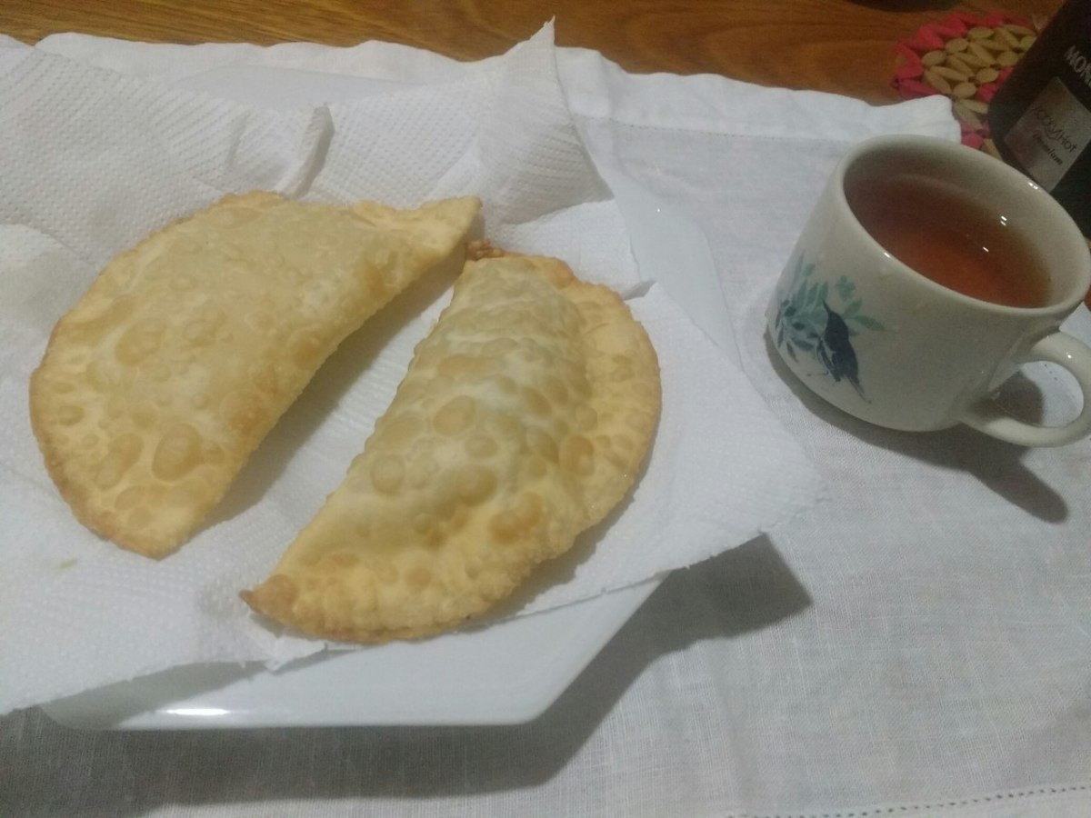 Fried pastries with a cup of tea.