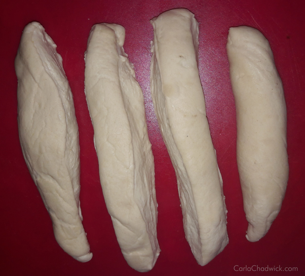 Packaged fresh pizza dough divided into four strips