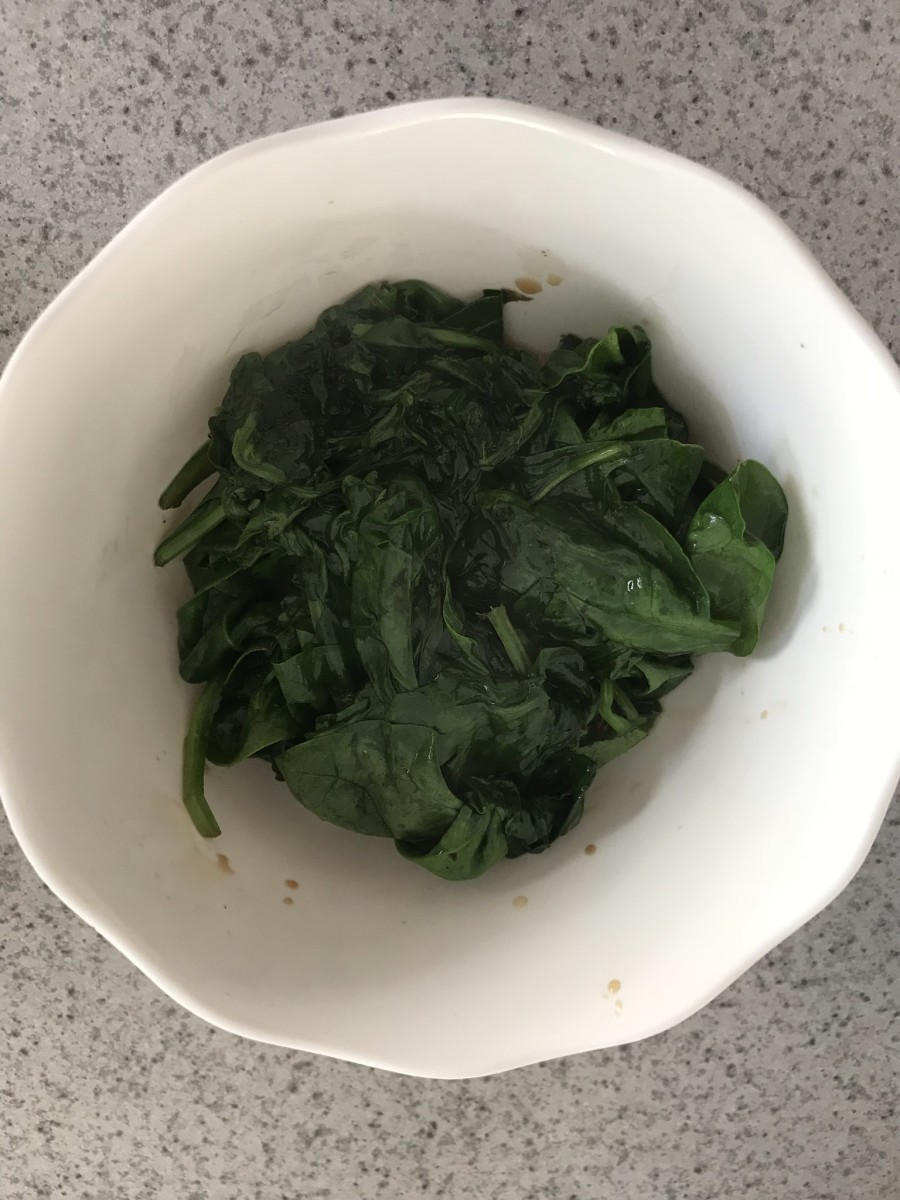 A whole bag of spinach cooks down a lot, so feel free to add more!