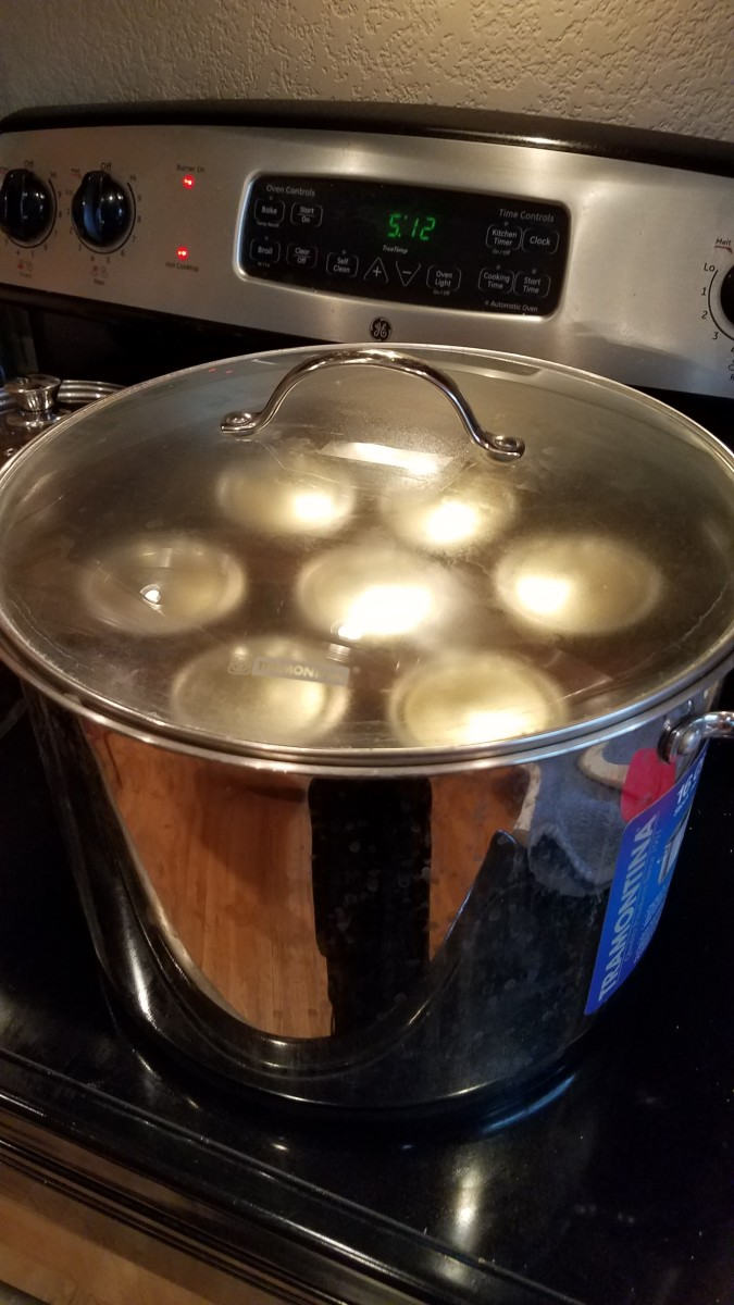Top with a lid and crank the heat to high on the stove. When your pot starts to boil over, tilt the lid to release the extra steam, set your timer, and turn the heat down a notch or two. You want your water to boil vigorously throughout canning.