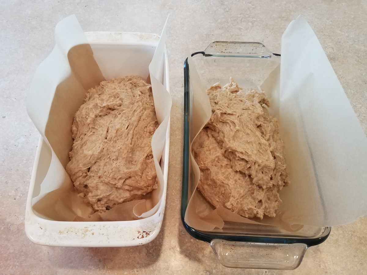 Pour out your dough and mix one more time on the counter. Then separate the dough into two pieces and put those into your loaf pans.