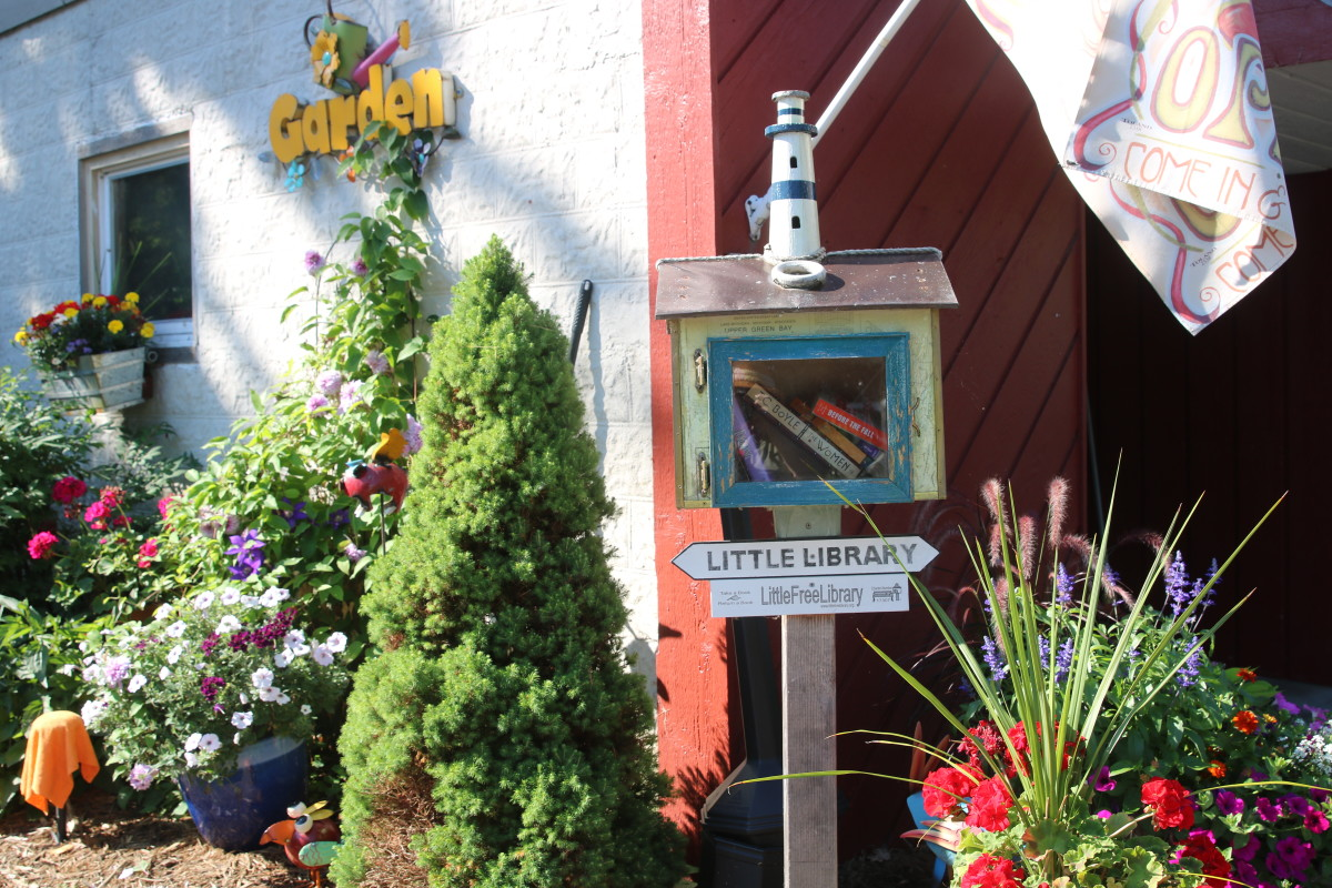 Brew Coffeehouse of Door County free little library and garden sign
