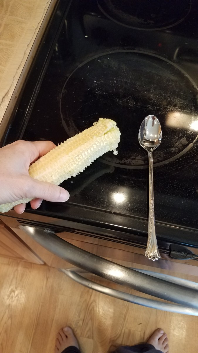 Fish out your corn cobs and scrape them down with a spoon or knife into your pot to get all of the leftover kernels and milk from your cobs.