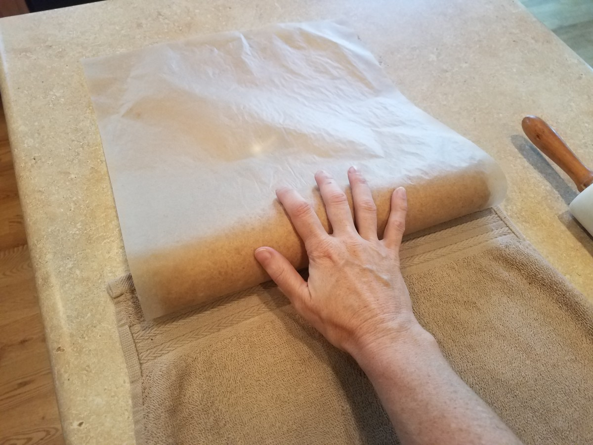 Using your parchment paper, roll the dough into a log starting from the short side.