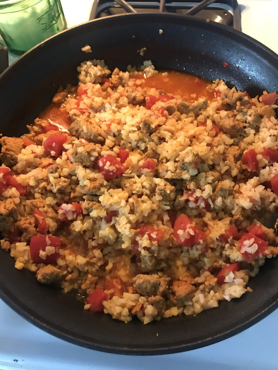 Turkey with tomatoes and cauliflower rice.