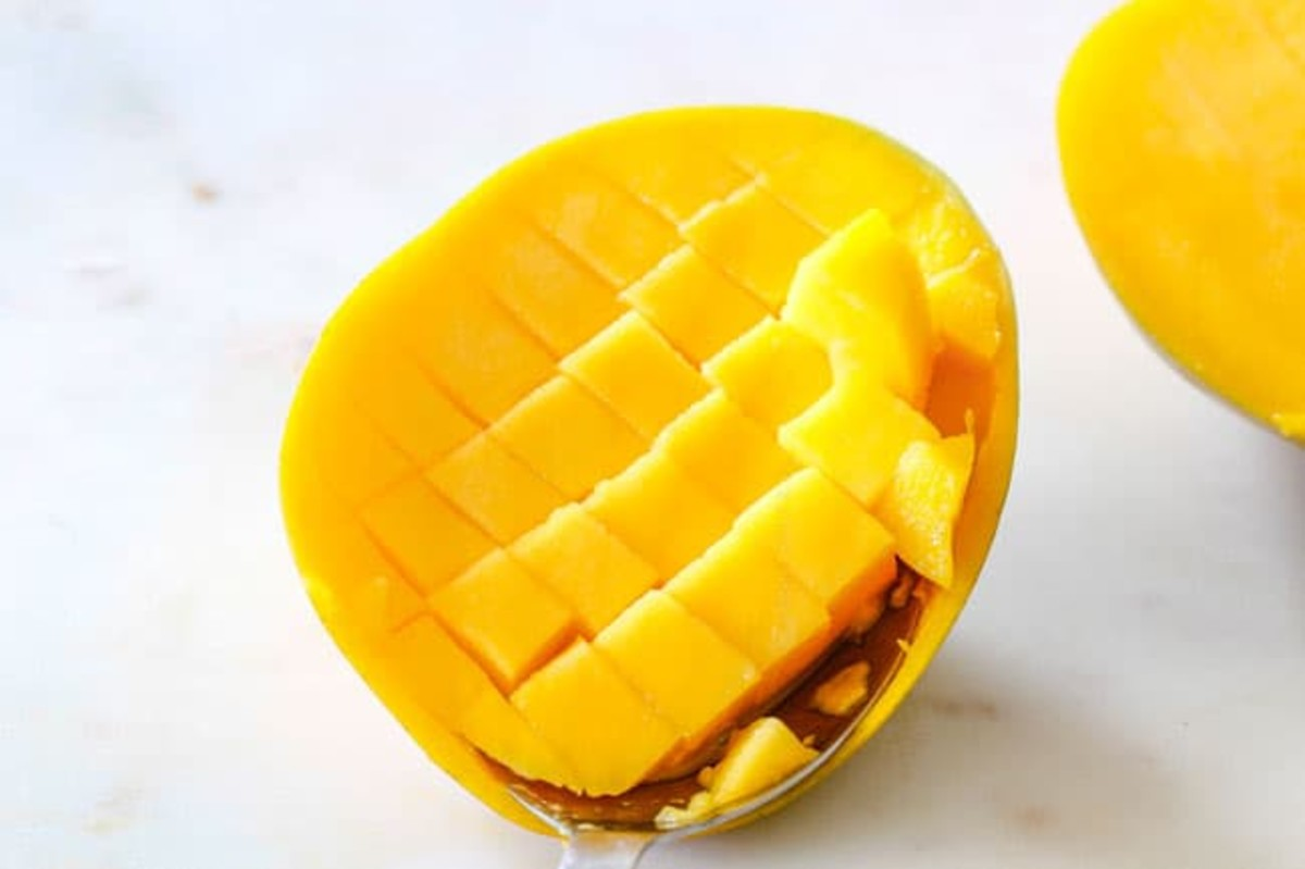 Scored mango ready to be scooped out.