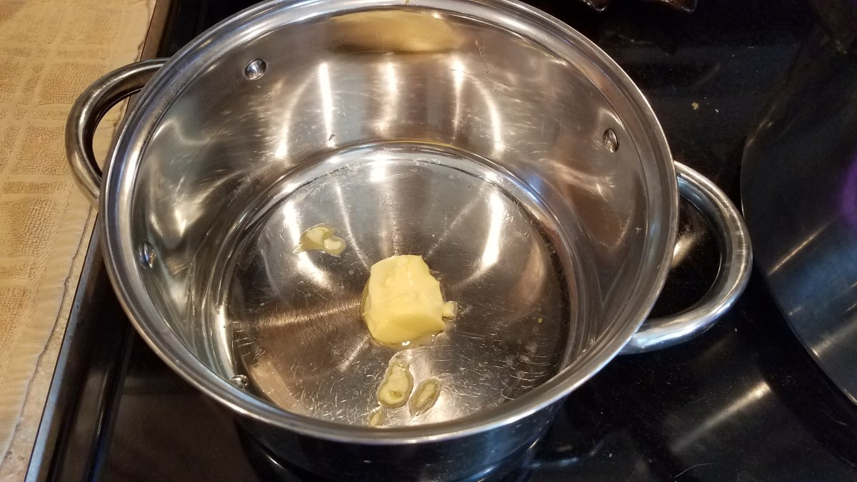 Melt some butter in a large pot on the stove over medium heat.