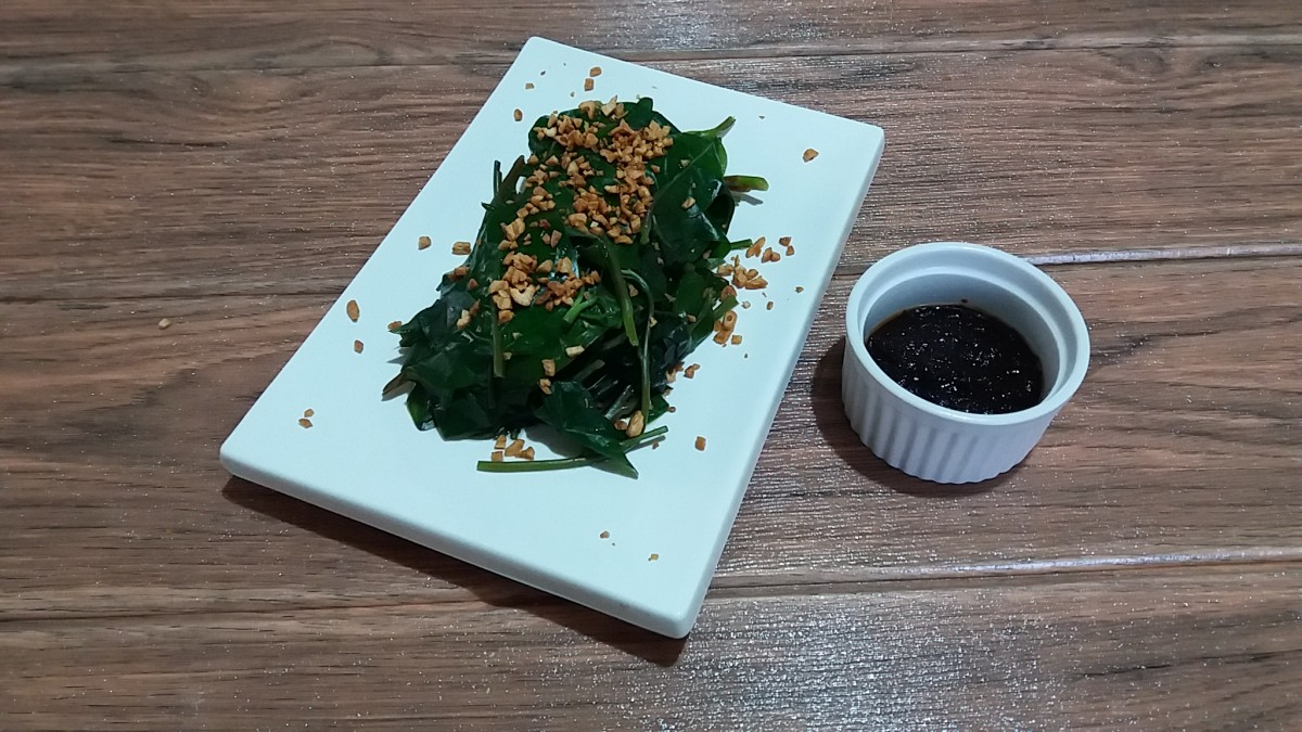The finished product: water spinach with shrimp paste and a toasted garlic topping.