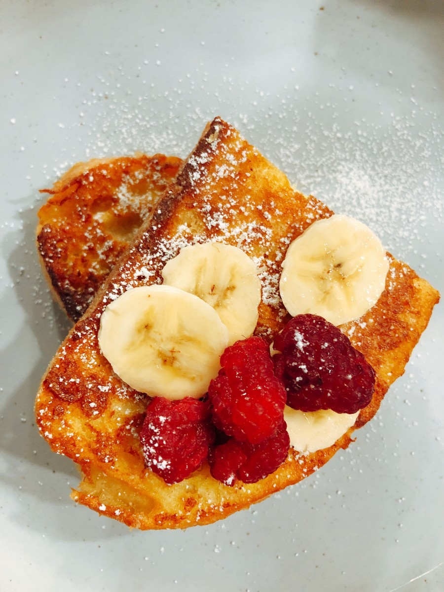 I like my French toast with fresh sliced fruits such as banana, strawberries, and red raspberries.