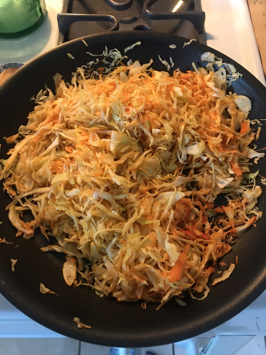 Shredded cole slaw mix after seasoning and cooking.