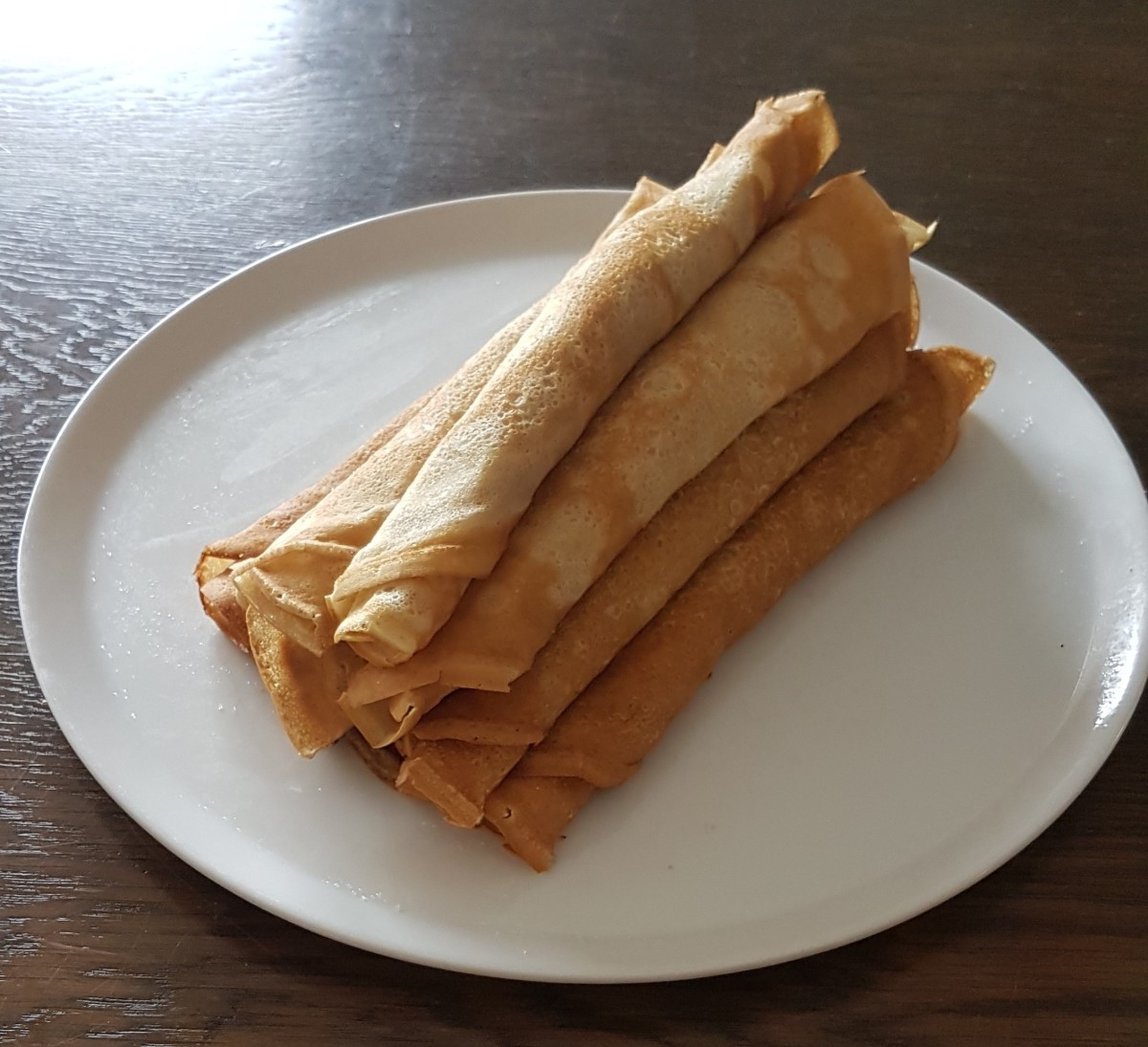 Rolled up Icelandic pancakes with sugar.