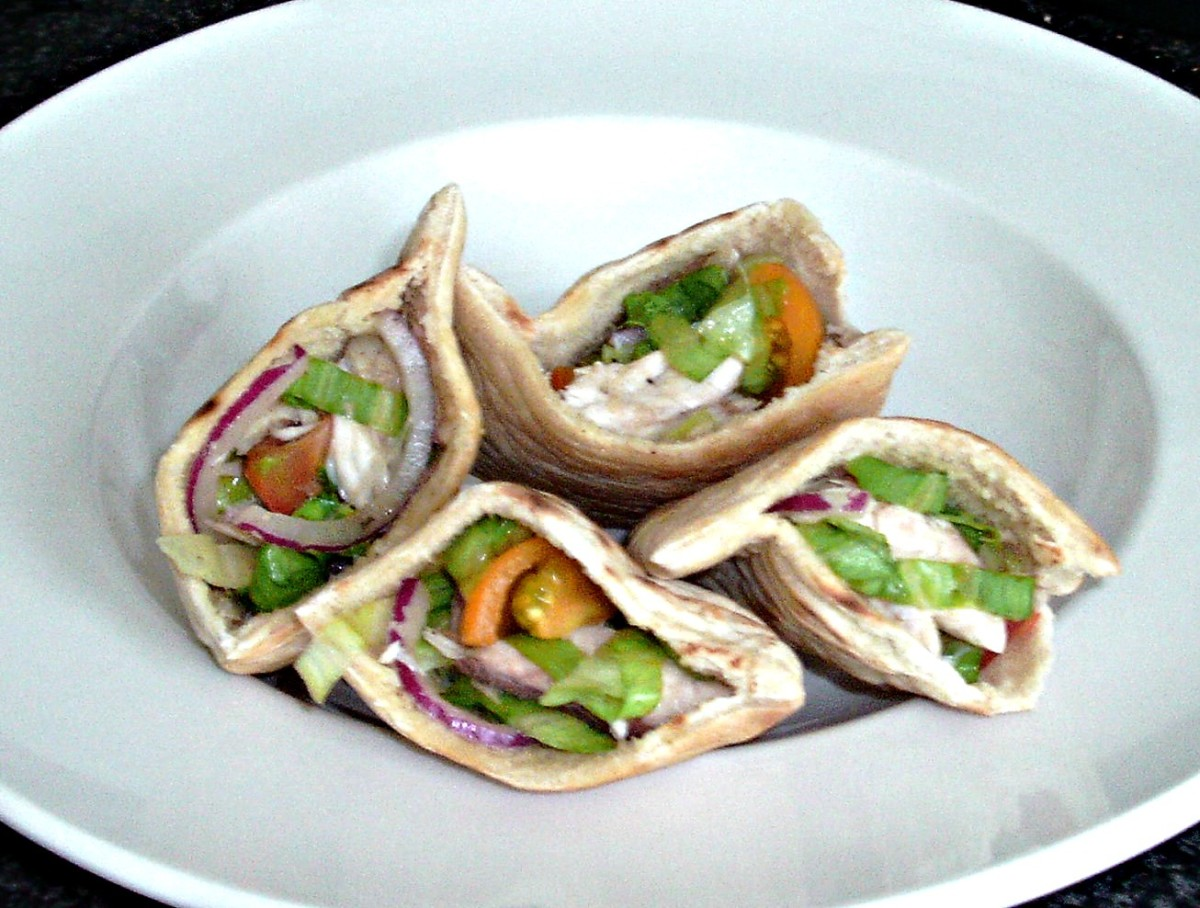 Smoked mackerel salad served in halved pitta pocket cups