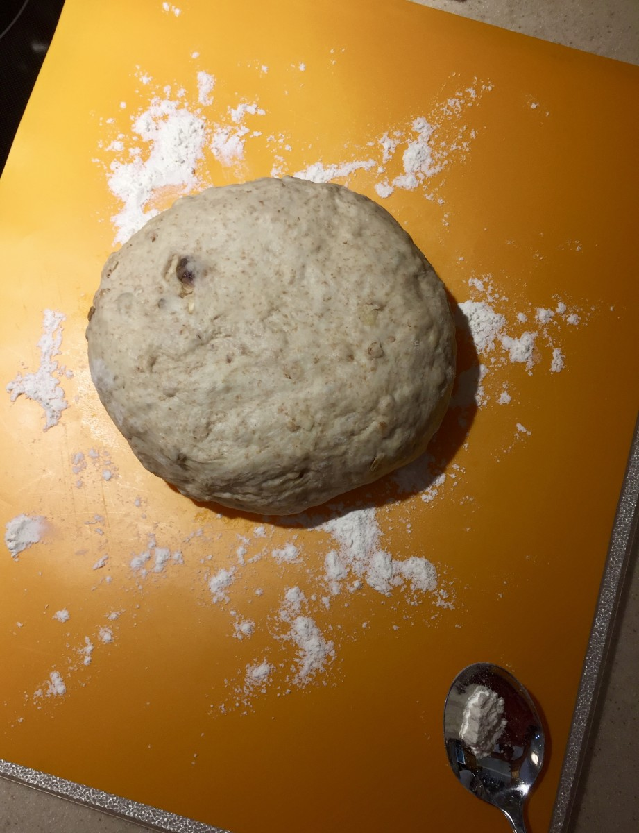 Punch the dough down and place on a floured board. Divide equally and flatten into eight discs.