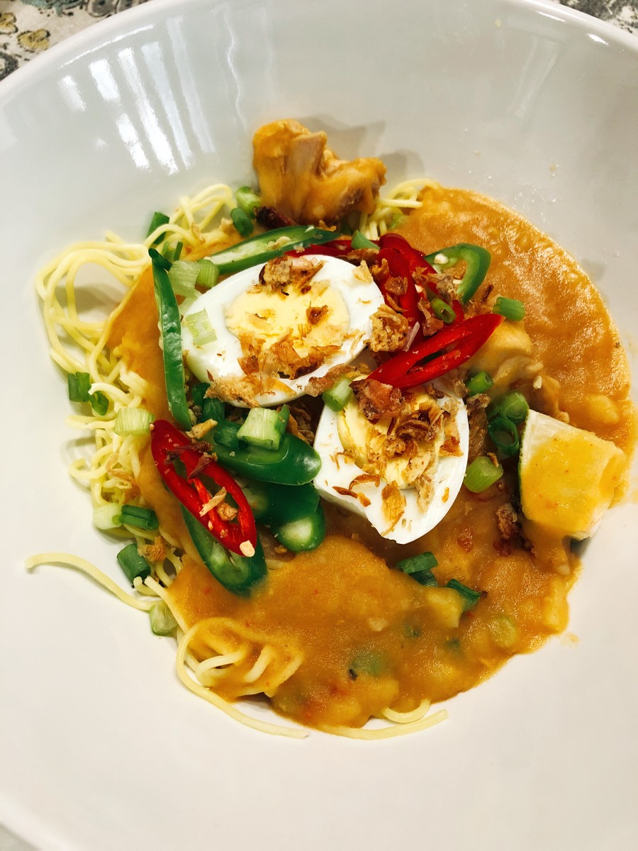 Garnish the top with the scallions, hard-boiled eggs, fried onions, and green chilies.
