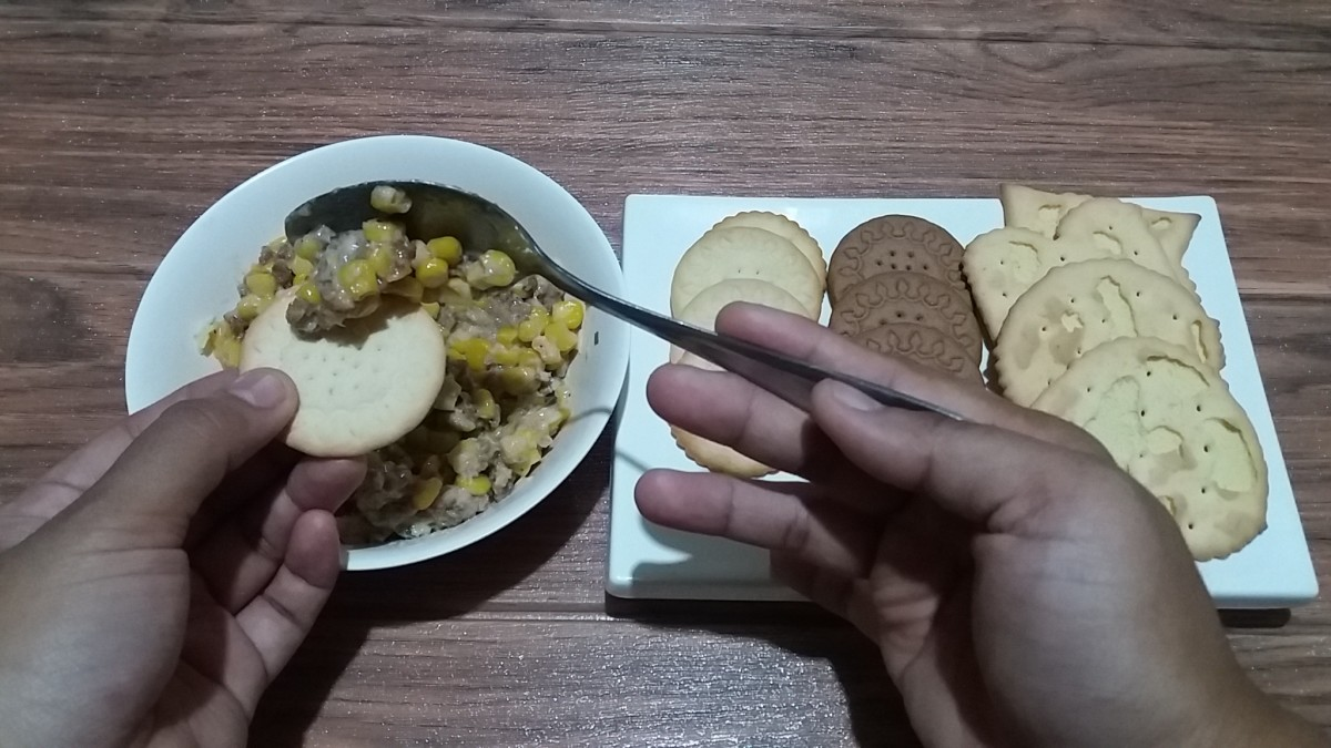cheesy corn and sausage dip with assorted biscuits