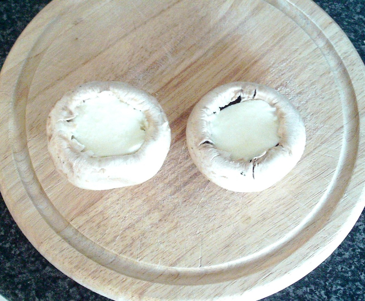 Mozzarella slices are fitted in to mushroom cavities