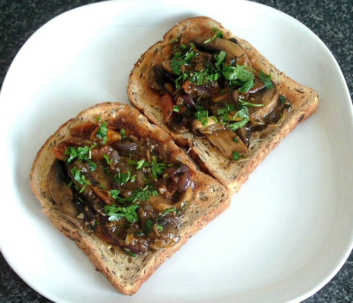 Curried garlic mushrooms and tomatoes are served on wholegrain toast