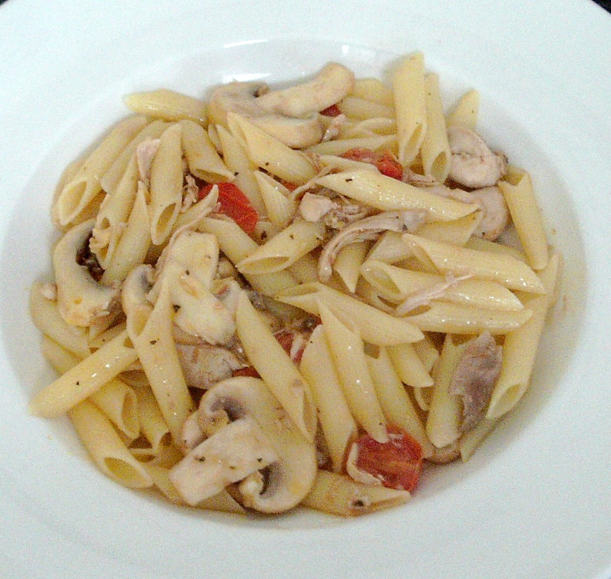Poached chicken thigh meat and garlic mushrooms penne pasta