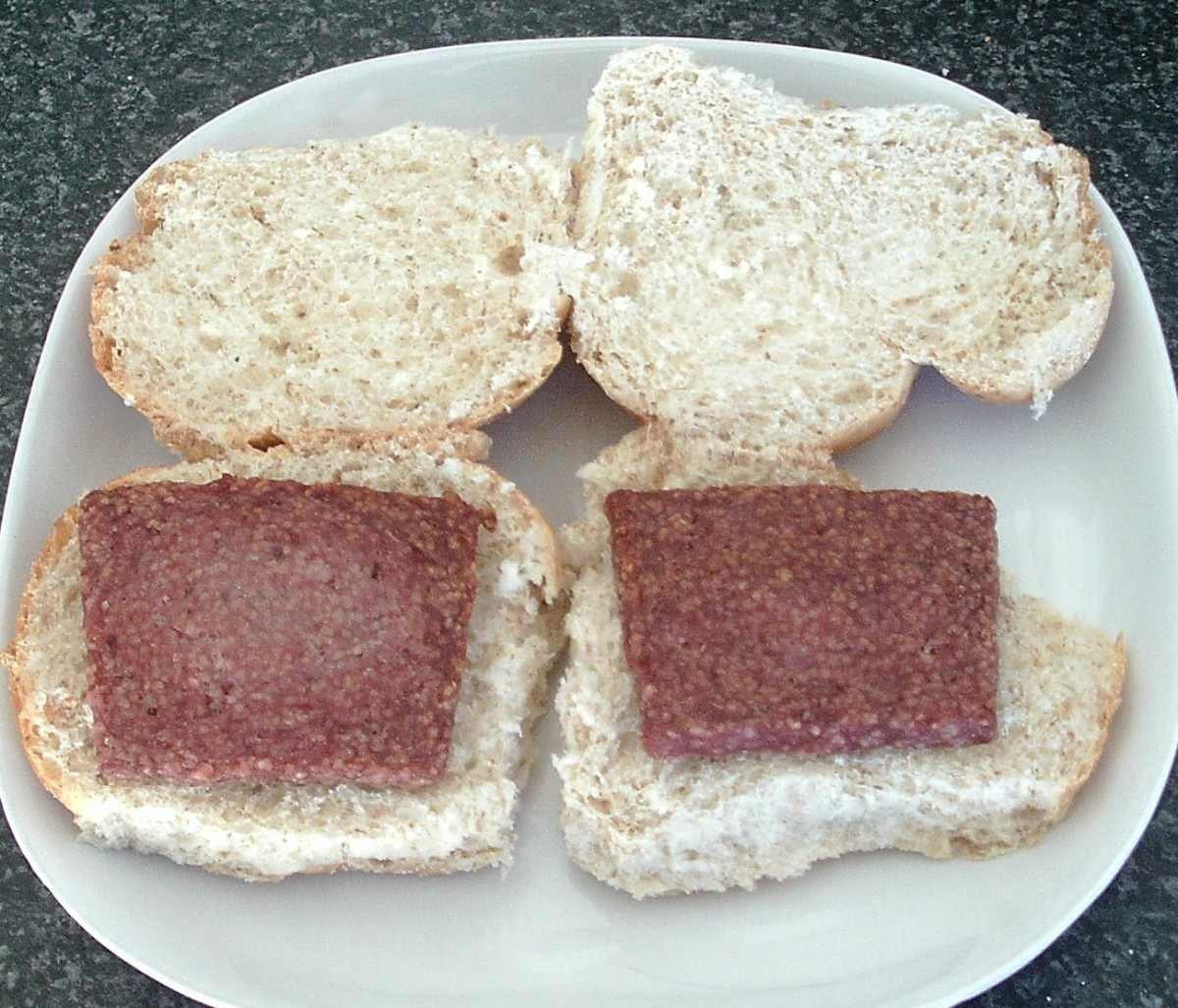 Sliced sausages are laid on bread rolls