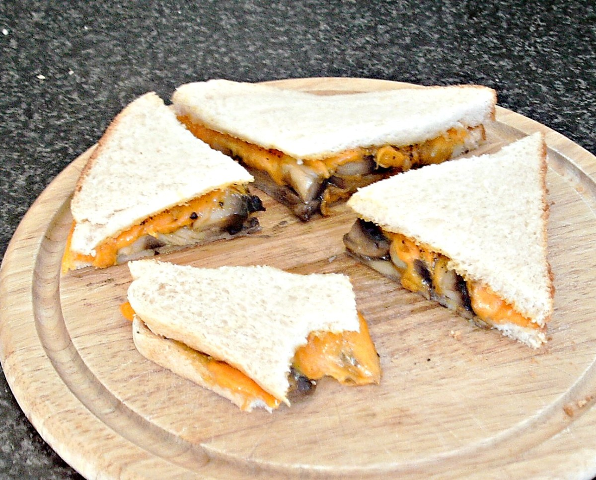 Garlic mushrooms and melted cheese sandwich is simply cut and served