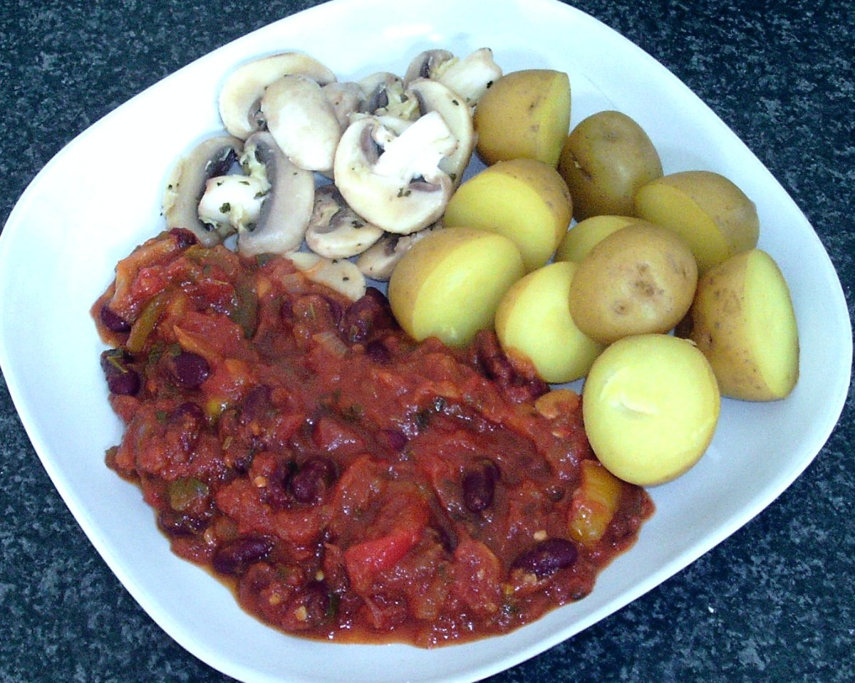 Sauteed garlic mushrooms are served with vegetable chilli and turmeric spiced potatoes