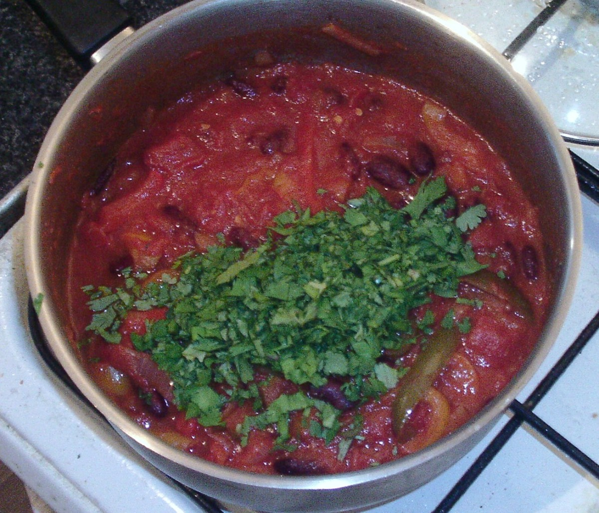 Coriander leaf/cilantro is added to chilli at last minute
