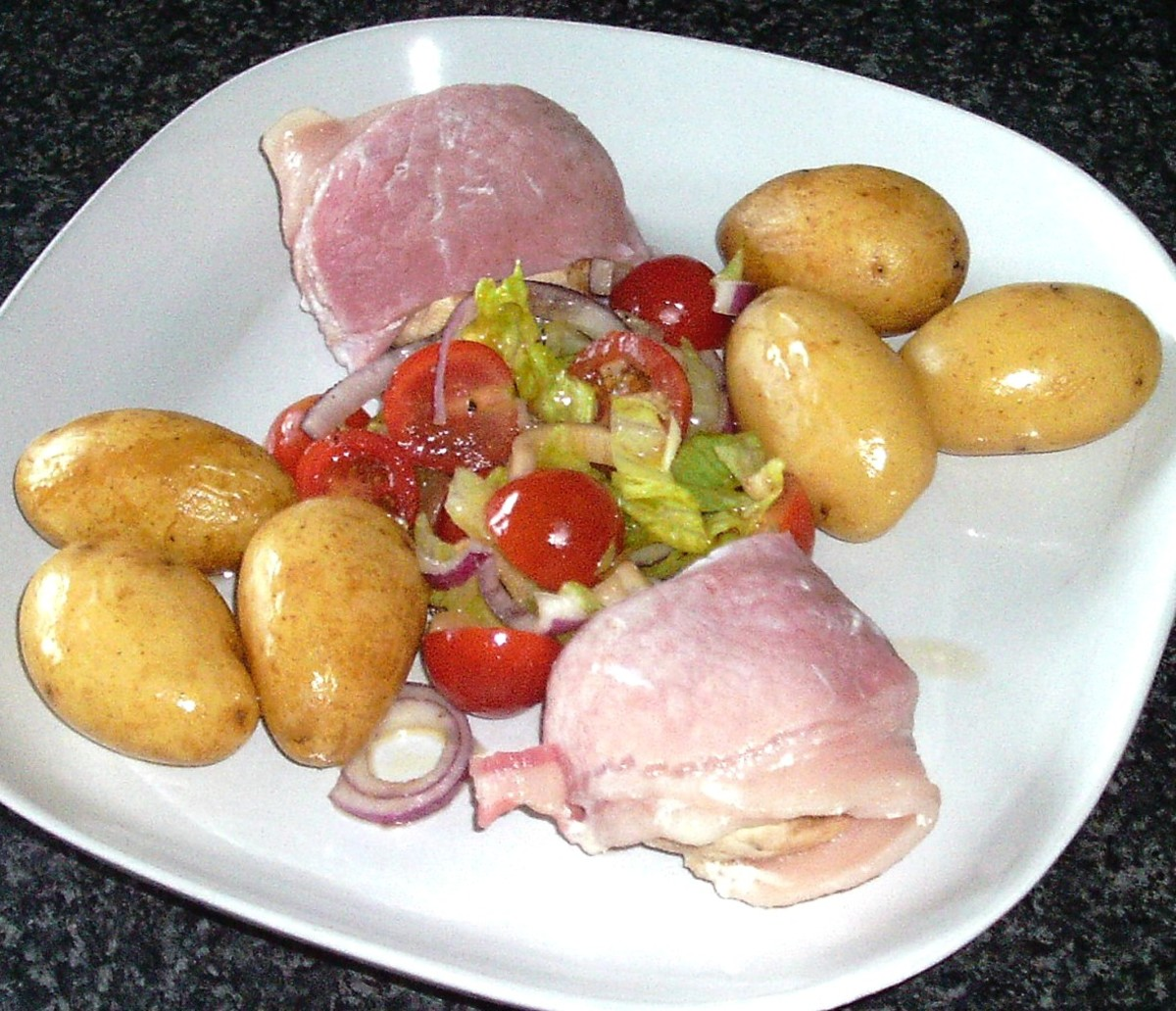 Garlic mushroom and mozzarella bacon wrapped mushrooms are served with boiled potatoes and dressed simple salad