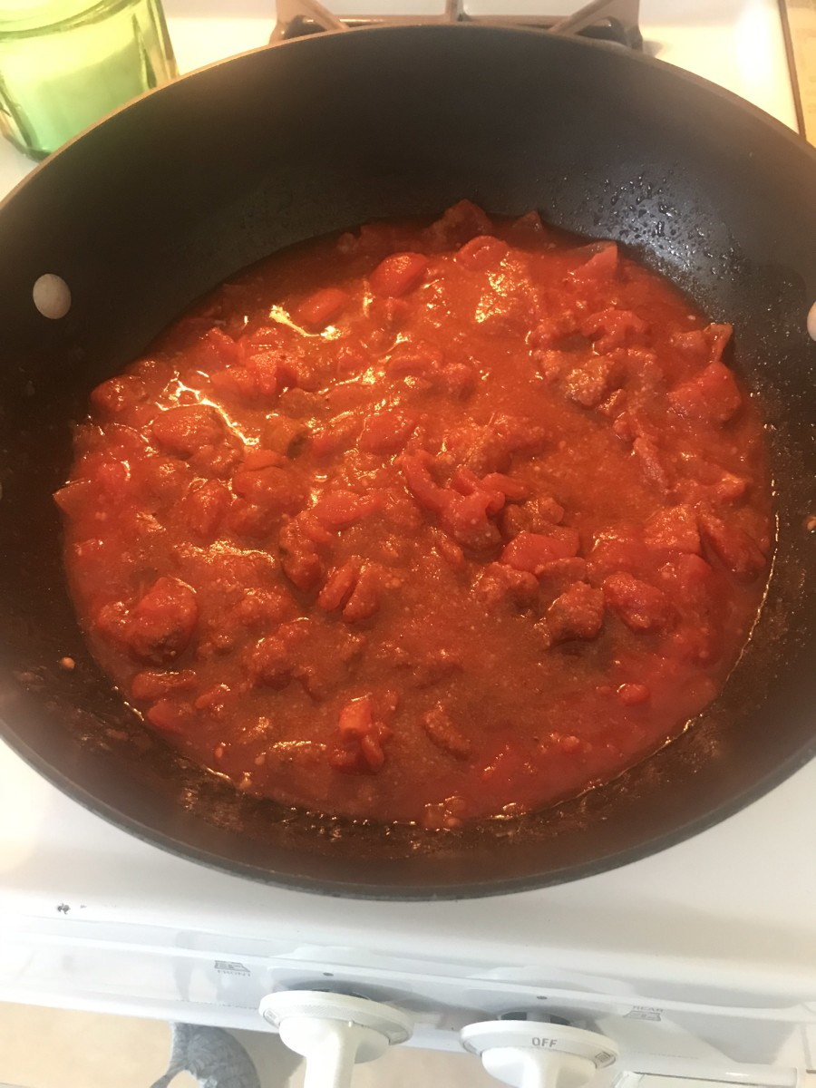 Cooking the tomatoes with seasoning.