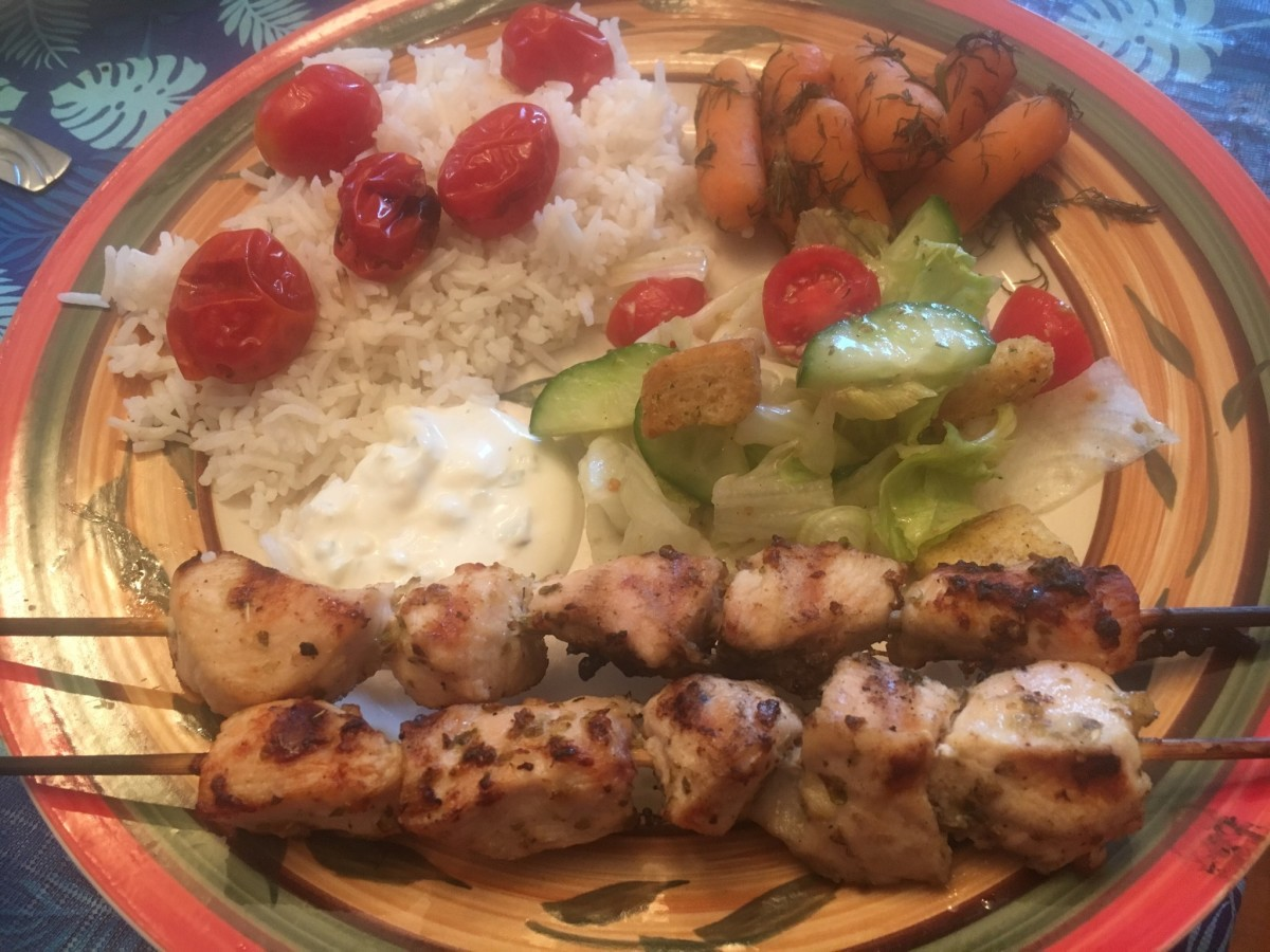 Chicken Souvlaki served with Basmati Rice with Grilled Cherry Tomatoes, Carrots with Dill, Greek Salad and a side of Tzatziki Sauce