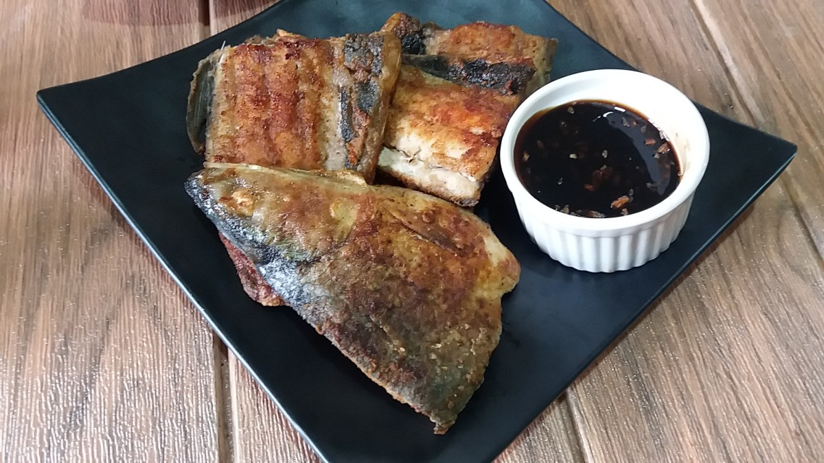 pan fried milkfish served with garlicky sweet soy glaze