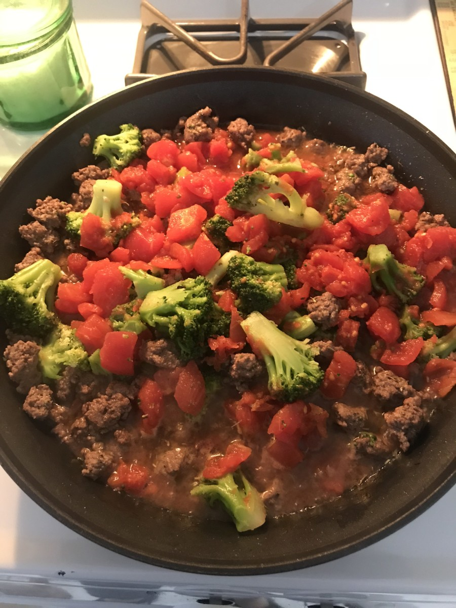 Add the spices, tomato, and broccoli.