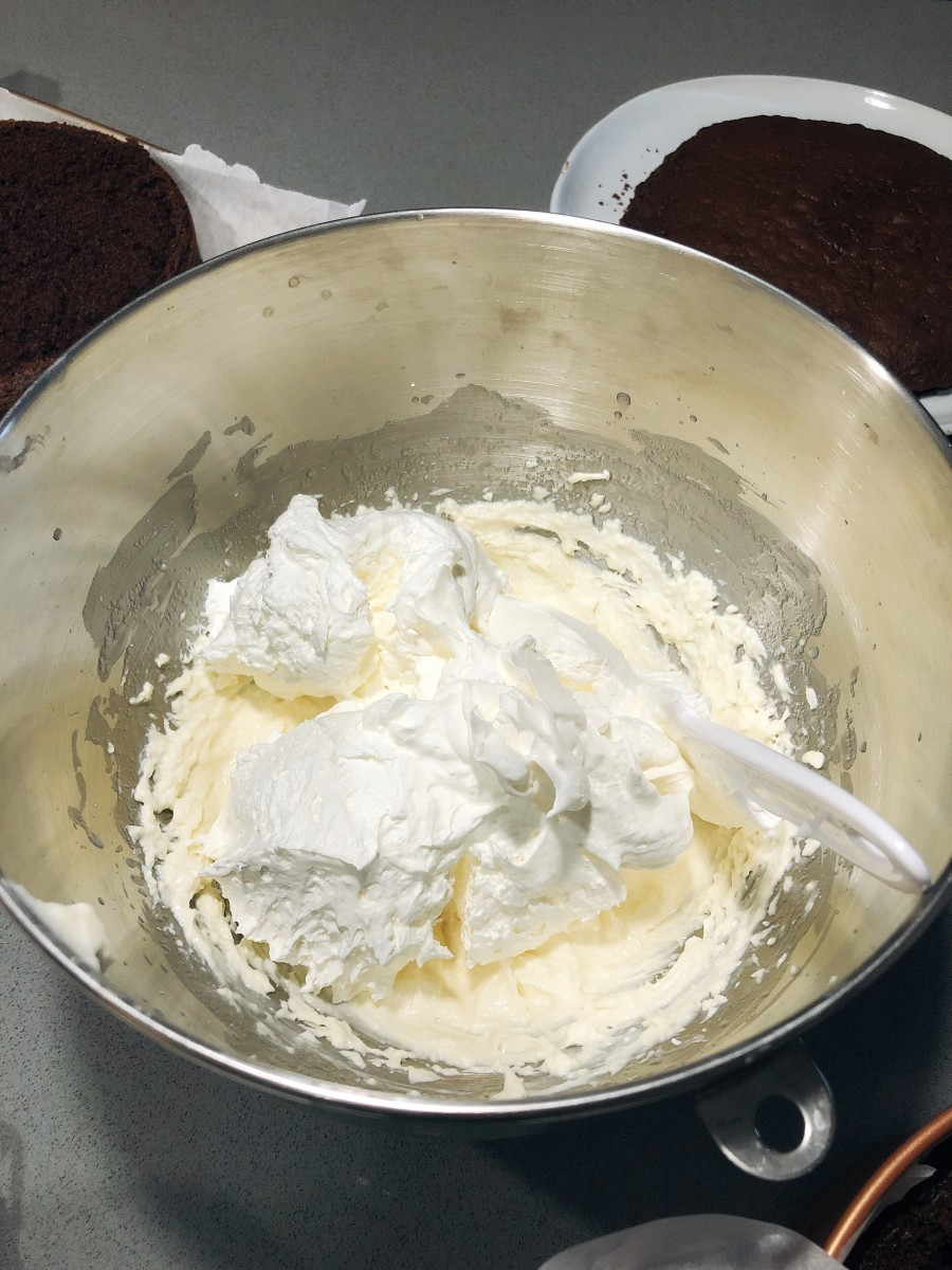Fold in the cool whip into the cream cheese mixture.