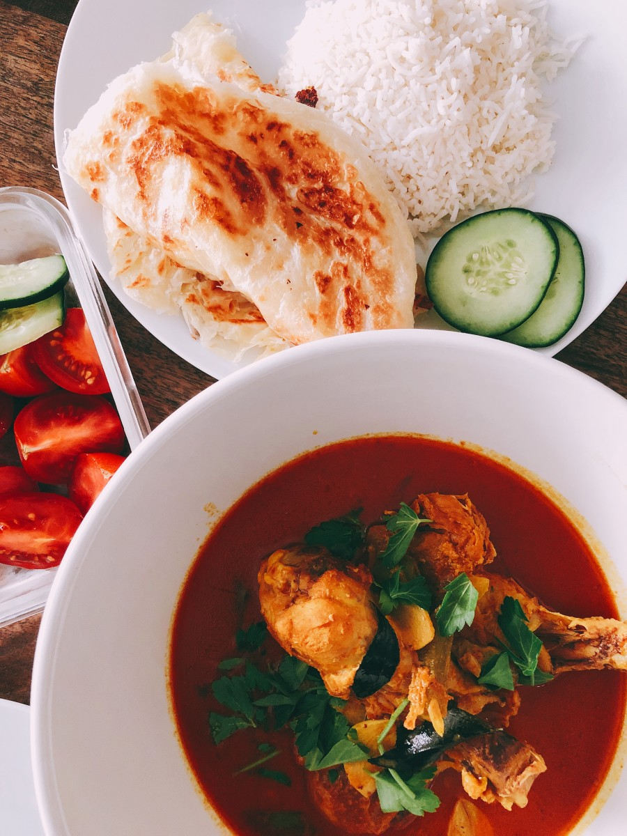 Chicken curry is ready with steamed white rice and roti. Perfect for dinner.