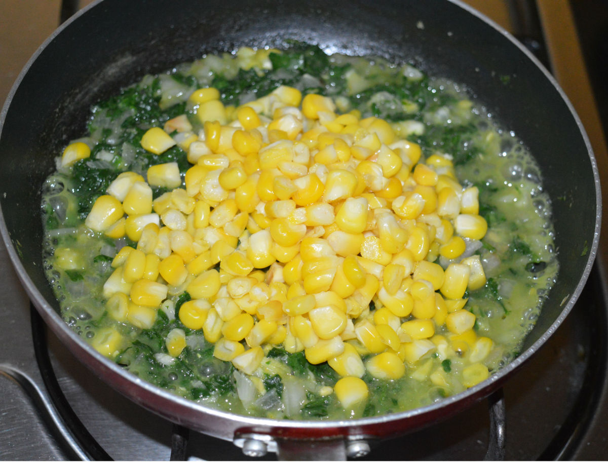 Step four: Add the boiled sweet corn. Add 3 cups of water. Throw in pepper powder.